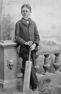 Edward Staunton posing with a cricket bat